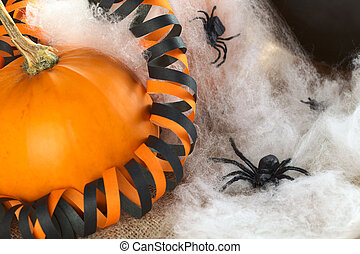 Halloween decoration consisting of pumpkin, plastic spider,...