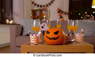 halloween decorations and treats on table at home - ...