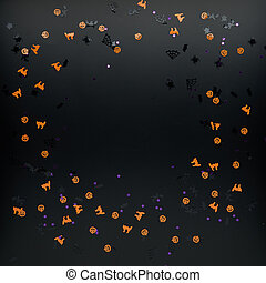 Halloween decorations. Confetti on black background. Halloween concept. Flat lay, top view, copy space