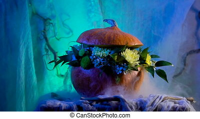 Halloween, filled with holiday traditions, symbols and details. Flower arrangement on the basis of the pumpkin