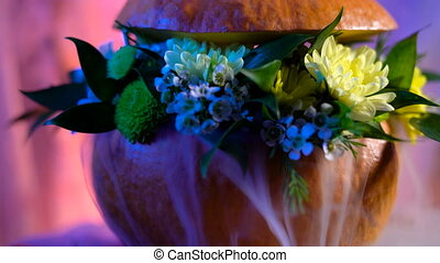 Flower arrangement on the basis of the pumpkin. Mystic steam...