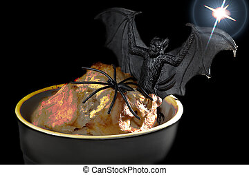Halloween food. Spooky glowing lava sponge with fun novelty spider and vampire bat.