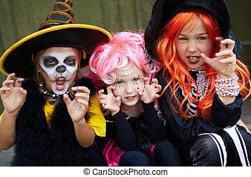 Halloween fright - Portrait of three Halloween girls looking...