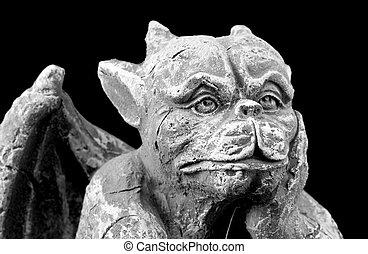Halloween gargoyle - Closeup of a small porous stone...
