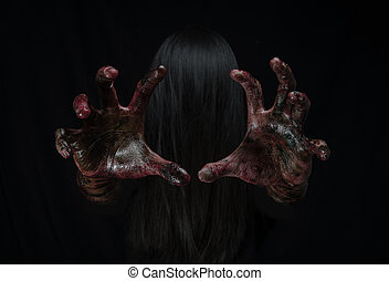 Halloween girl with scary hand
