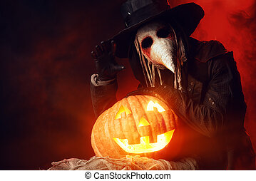 halloween hero - Frightening plague doctor stands with a...