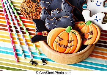 Halloween homemade gingerbread cookies over tablecloth