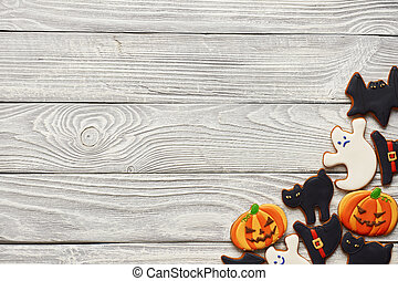 Halloween homemade gingerbread cookies over wooden...