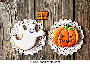 Halloween homemade gingerbread cookies over wooden table