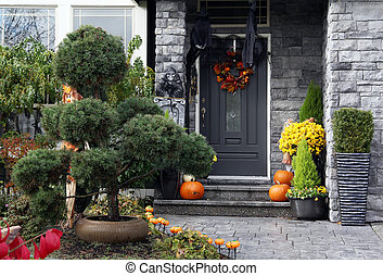 Halloween house - Front door to a house decorated with ...