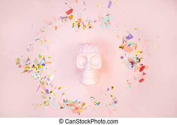 Halloween human pink skull on pastel background with free space for text.