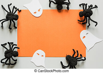 Halloween invitation with black spiders on grey. Flat lay, top view, copy space.