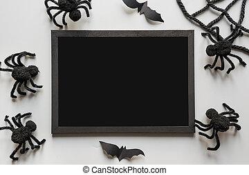 Halloween invitation with black spiders on grey.