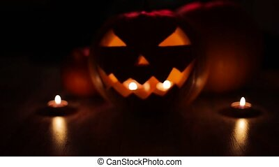 halloween jack-o-lantern burning in darkness - halloween and...
