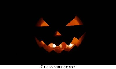 halloween jack-o-lantern burning in darkness - halloween and...
