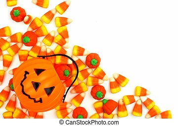 Halloween Jack o Lantern candy holder with candy pumpkins and candy corn corner border over white
