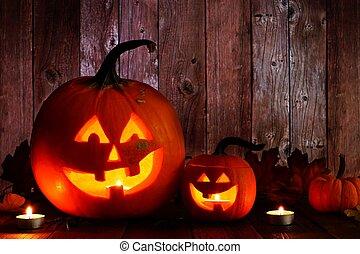 Halloween Jack o Lantern night scene with wood background