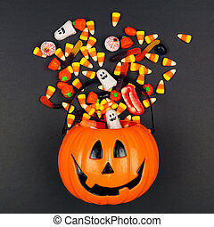 Halloween Jack o Lantern pail with spilling candy, top view ...