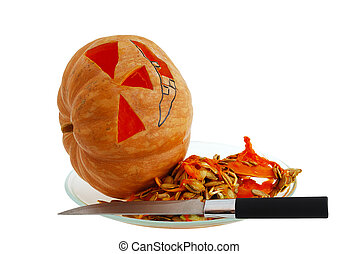 Halloween jack o lantern preparation - carving pumpkin with knife isolated on white background