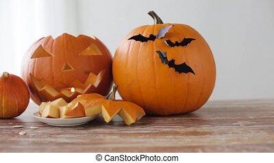 halloween jack-o-lantern, pumpkins with tablet pc - holidays...