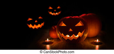 halloween jack-o-lanterns burning in darkness - halloween...