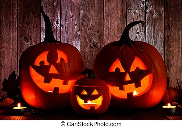 Halloween Jack o Lanterns, night scene against wood