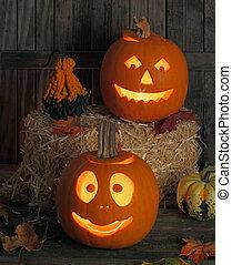 Halloween Jack-O-Lanterns - Two smiling jack-o-lanterns one...