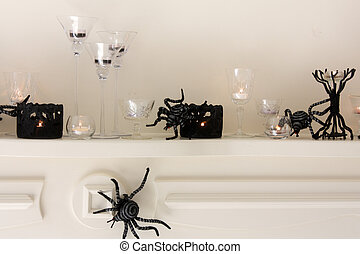 Halloween Mantle display - Black and silver spiders crawl...