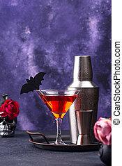 Halloween martini cocktail on purple background