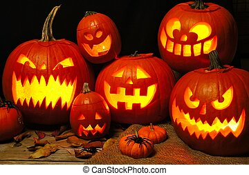 Halloween night scene with a group of illuminated Jack o Lanterns