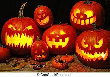 Halloween night scene with a group of illuminated Jack o Lanterns