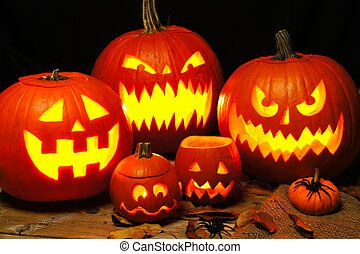 Halloween night scene with a group of spooky illuminated Jack o Lanterns