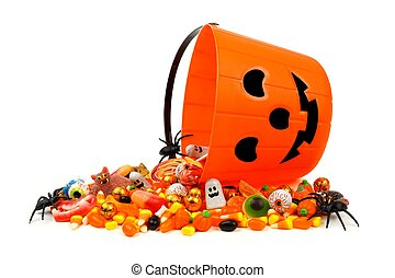 Halloween pail with spilling candy