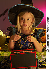Halloween party with a child holding sign