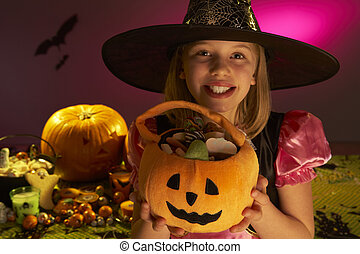Halloween party with a child showing candy