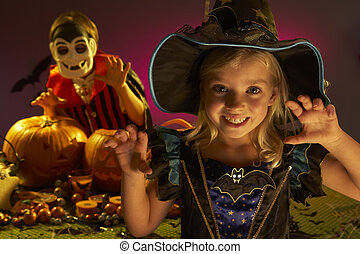 Halloween party with children wearing scaring costumes