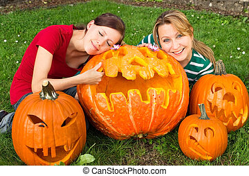 Halloween - Two girlfriends with several self-carved...