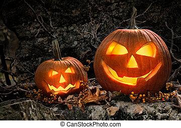 halloween, pompoennen, op, rotsen, op de avond