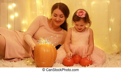 Halloween. Princess child girl with Mother playing with...
