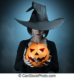 Halloween pumpkin and gray mouse - Halloween witch holding a...