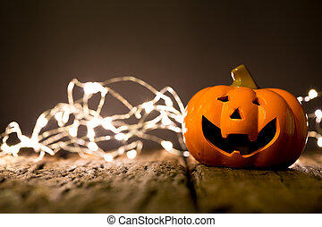Halloween pumpkin and lighting on wooden background
