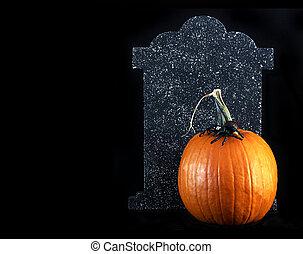 halloween pumpkin and tombstone