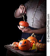 Halloween pumpkin and woman hands