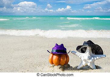 Halloween pumpkin background with starfish on the beach