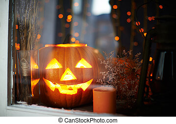 Halloween pumpkin - Big pumpkin with burning candle inside ...