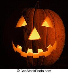 Halloween pumpkin. - Carved Halloween pumpkin glowing in the...