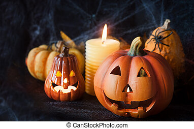 Halloween pumpkin decor with candle and spiders