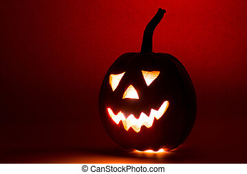 Halloween pumpkin, funny face on red background