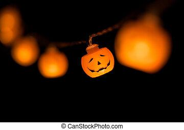 Halloween pumpkin garland glowing in the dark