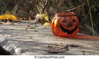 Halloween pumpkin glass candlestick. Seasonal party decoration